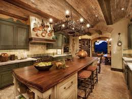 rustic kitchen island: rustic kitchen with terracotta tile floors jefferson etruscan bronze  light island chandelier