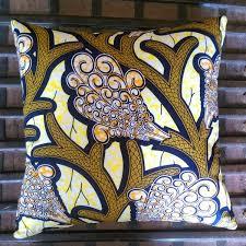 <b>African</b> wax fabric cushion in blue, gold and black <b>geometric pattern</b>