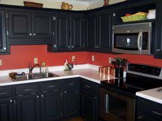 cabinets black red kitchens black cabinets amp red walls its definitely a maybe for my kitchen