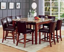 room fascinating counter height table: fascinating countertop height with black leather chairs and glass window plus wall art also wall decor for dining room design ideas