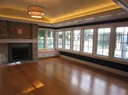 sunroom with stone fireplace tray ceiling led lighting leather finishes wide transitional ceiling tray lighting
