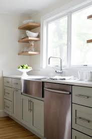 green kitchen features sage cabinets