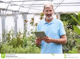 portrait of s assistant in garden center digital tablet portrait of s assistant in garden center digital tablet