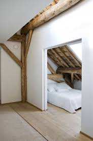 attic bedroom exposed rafters add a nice dose of warmth to this little bedroom bedroom home amazing attic ideas charming