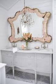 white shabby chic bathroom with an oversized blush vintage mirror i so love this mirror antique dresser framed leaning mirror shabby chic