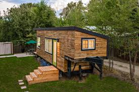 Stunning Tiny House Built On A Gooseneck Flatbed TrailerTrailer Front