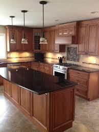kitchen island granite top sun: black granite countertops in a classic wooden kitchen with kitchen island