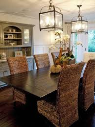 dining table parson chairs interior: charming dining room design using rattan parsons chairs plus glass lanterns and wooden floor