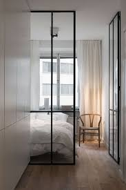 white kitchen windowed partition wall: if you left that little longer wall between the kitchen and living dining area i can see it being windowed like this to carry flavor of the slider doors