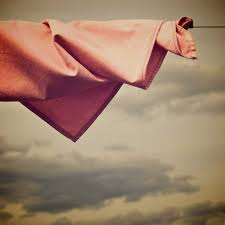 three poems by diti ronen world literature today salmon colored cloth in a clothesline
