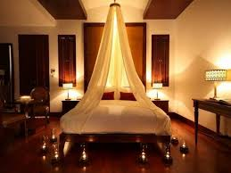 romantic bedroom design canopy bed soft ambient lighting candles bedroom mood lighting design