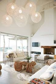 beach house design with high ceiling and globe pendant lightings and interesting couch beach house lighting fixtures