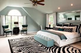 bedroom with light blue walls bedroom traditional with black and white rug ceiling fan black blue bedroom