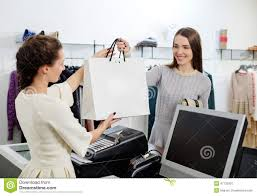 w and shop assistant in a showroom stock photo image  w and shop assistant in a showroom