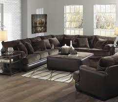 furniture furnishing light brown sofa with black corner living table on soft carpet wooden laminate black sofa set office