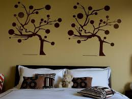 bedroom painting designs: tree wall paint design in kids bedroom