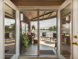 door patio window world: lake and balcony view through patio doors