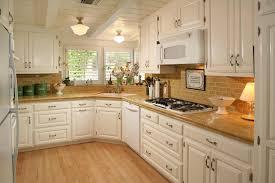 beautiful white kitchen cabinets: beautiful white kitchen cabinets brown varnish wood full area floor stainless steel modern range hood white stained wooden kitchen island white stained wood