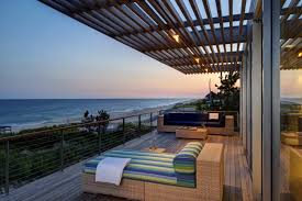 wooden balcony floor with rattan sofa and chaise lounge for beah house outdoor furniture balcony outdoor furniture