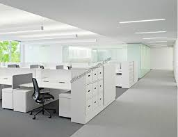 drawer pulls non handles and what appears to be cable organizing cubbies at the back of the desktop pics purportedly from an apple office remodel apples office