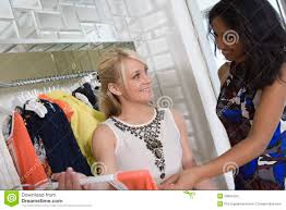 shop assistant clothes store stock photos images pictures shop assistant helping customer at clothes shop stock images
