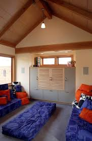 loft playroom exposed beams floor cushions carpet tiles and tv consoles awesome family room lighting