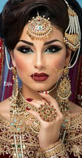 thin nose ring like this indian bride cost in bridal