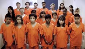 Are These Immigrant <b>Children</b> in <b>Orange</b> Jumpsuits?