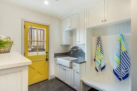 beach style laundry room and mudroom combo with yellow door beach style laundry room