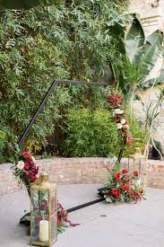 Modern <b>Hexagon Wedding Arch</b> with Red Flowers