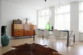 view in gallery moooi random lights add to the aura of the midcentury dining space add midcentury modern style
