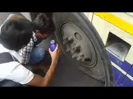 Image result for images of bus bus tyre punctured