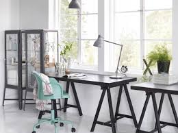 a home office with tornliden desk in black black fabrikr glass cabinet and roberget swivel amazing choice home office gallery office furniture