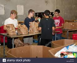 food drive cans stock photos food drive cans stock images alamy teens volunteer sorting cans of food in the warehouse of the san antonio food bank in