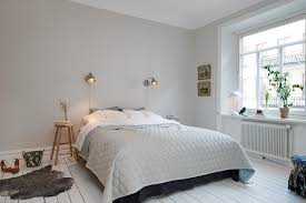 big modern bed in a white bedroom interior design along with simply woode stool and small captivating white bedroom