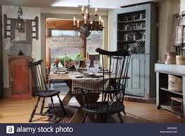 corner cabinets dining room: rustic style dining room with corner cabinet and pewter items usa