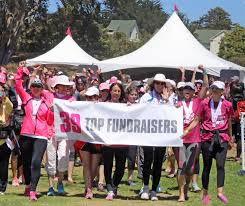 dr alisa gean walks miles raises thousands to fight breast dr alisa gean holding the top fundraisers banner on the far left raises a hand in support of the fight against breast cancer