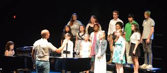 bevan keating artistic director for wildwood academy of music and bevan keating conducts a choir of teenaged vocalists at wama accompanied by collaborative artist kyung