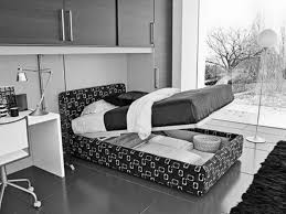marvelous custom upholstery bed with storage also white bedside table as well as wall mounted cabinetry as decorate in modern small space black and white black white bedroom interior