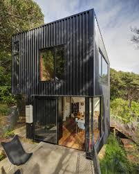 Modern Home During The Day Modern House Design Idea With Gray - Black window frames for new modern exterior