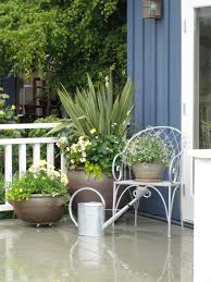 plant pots patio mediterranean planting pots patio traditional with blue board and battan chair cotta