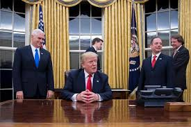 oval office floor. trinkets and ornaments are dotted around the oval office that directly link president trump to floor