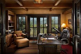 montana family compound example of a large mountain style home office design in other with beige charmingly office desk design home office office