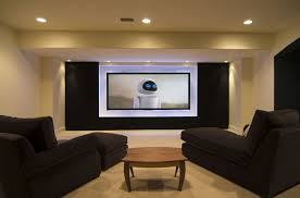 comfortable basement media room design with dark sectional sofa and wooden coffee table and home theater lighting fixture ideas cool basement bedroom basement bedroom lighting ideas