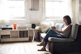 woman sitting on sofa using digital tablet amv photodigital visiongetty images amazing small living room furniture