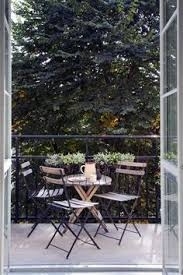 small rustic terrace balcony furnished small foldable