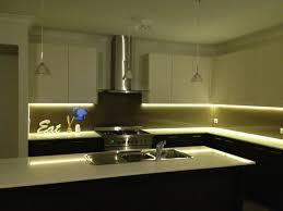 under cabinet led strip lighting and brushed nickel pendant lamp with clear glass shade above kitchen island above kitchen cabinet lighting