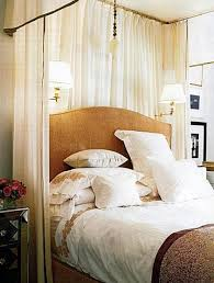 wall lights bedroom with swing arm sconces and candle sleeves mounted over a headboard bedroom sconce lighting
