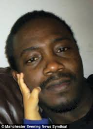 Abiodun David John who was arrested by police probing the French Alps massacre. Fraud Squad - article-0-15FD6087000005DC-963_306x423