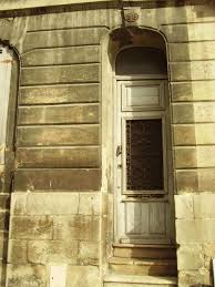 photo essay the beauty of doors vagobond is there a french family drinking bordeaux behind this french door can you almost hear the laughter oui